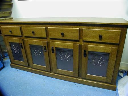Buffet with custom tins in doors