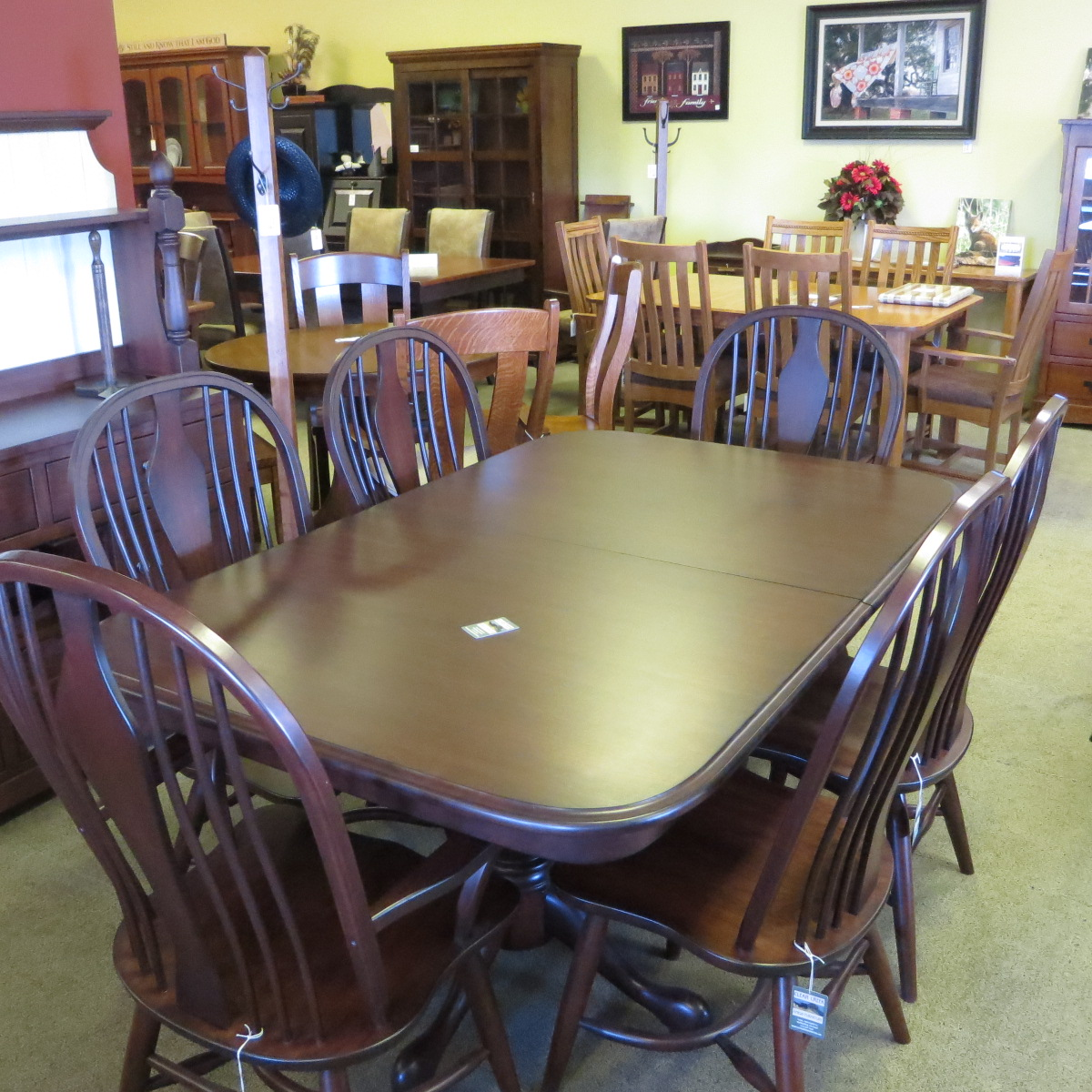 Double tulip pedestal base 42 x 66 with 2 leaves, 4 side chairs and 2 arm chairs in cherry