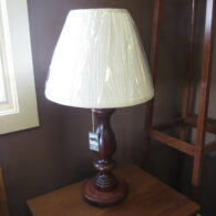Lamp with turned base