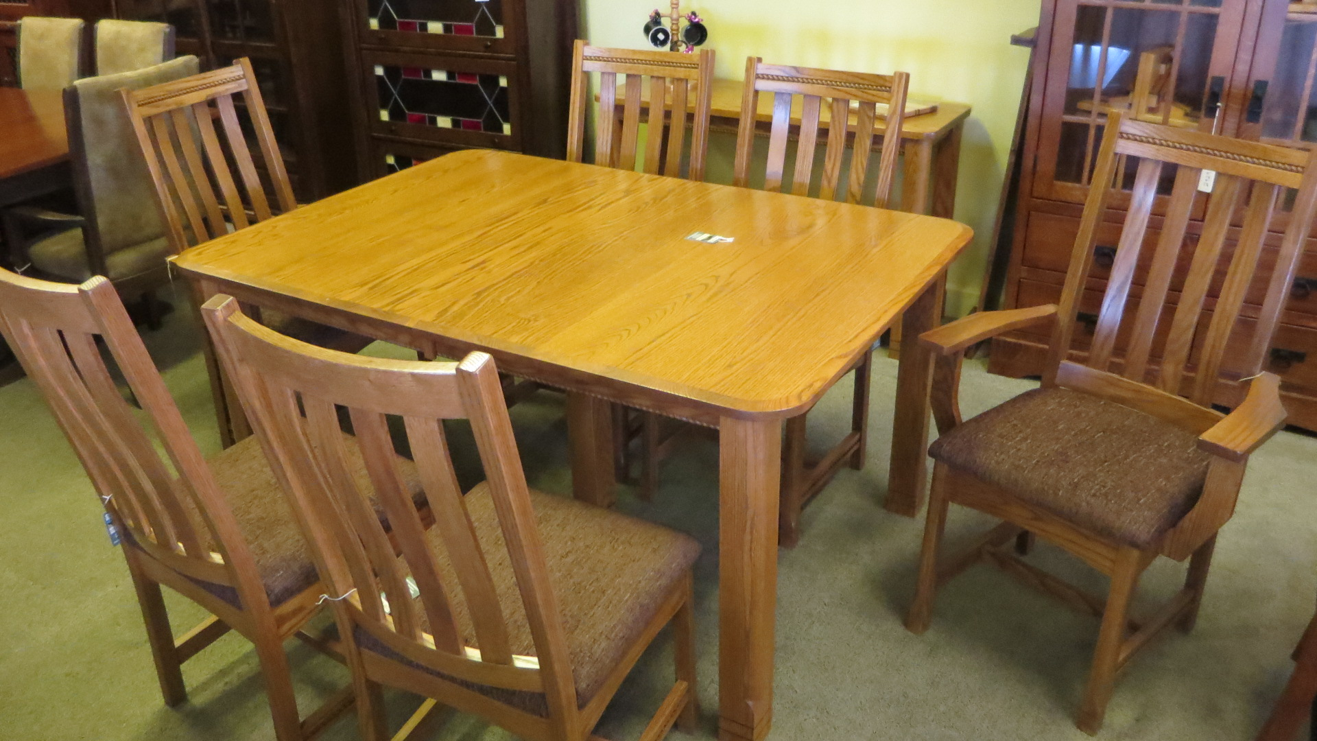 Westlake table with 4 sides and 2 arm chairs in oak