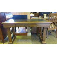 Hickory writing desk with leather inlay on top .